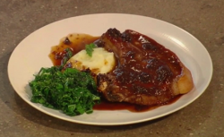 Andi's Pork chops with prunes and and kale dish on Christmas Kitchen