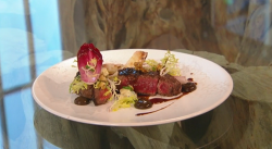 Luke Tipping Beef fillet with walnut ketchup, chicory, blue cheese salad and celeriac chips dish ...