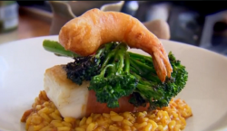 Paul Merrett and Lucy's hake wrapped in Serrano ham with risotto and broccoli on The Secret Chef
