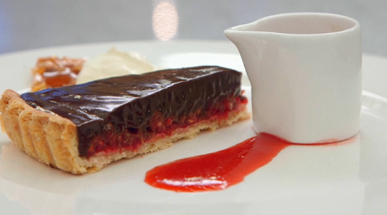 Faye's raspberry and chocolate tart with praline, cream and a raspberry coulis on Masterch ...