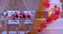 Keisha's 7 tier gold and floral wedding cake on Extreme Cake Makers