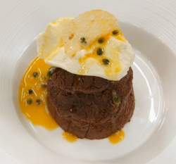 Angellica Bell's chocolate mousse cake with passion fruit coulis and Chantilly cream on Ce ...