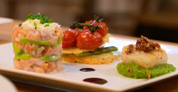 The King family scallop on a bed of pea and mint puree, Parmesan wafer biscuits with baby leeks  ...