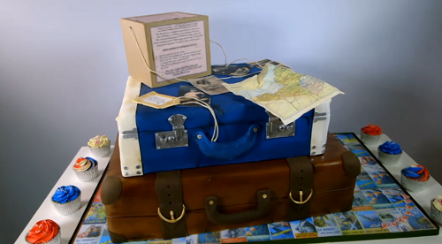 Eloise Durrant evacuee suitcase cake with cupcakes for a 90′s Birthday party on Extreme Ca ...