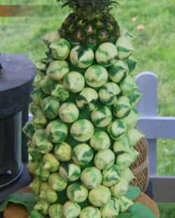 Ella's pineapple party meringue tower on The Great Celebrity Bake Off Stand Up to Cancer.