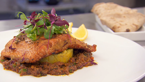 Moonira Masterchef's pan fried sea trout with mustard and turmeric potatoes, spicy tomato  ...