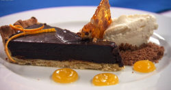 Blue team's chocolate ganache tart with orange gel and orange chantilly cream on Masterche ...