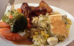 Josh and Martin's  chicken leek and mushroom pie with deep fried potatoes on Celebrity Mas ...
