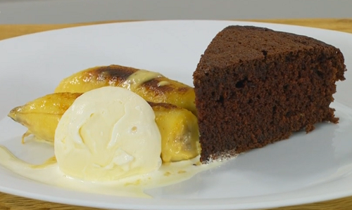 James Martin chocolate cake with caramel flambe bananas in rum served with vanilla ice cream on  ...