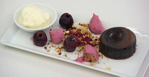 Spencer Matthews chocolate fondant with creme fresh sorbet and brandy soaked cherries dessert on ...