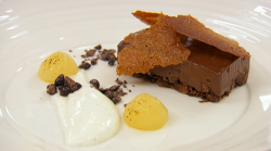 Michelle's dark chocolate and cardamom slice with poached pear and vanilla sheep's y ...