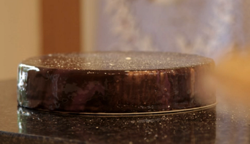 Dominic's ruby  mirror glazed cake with a galaxy star effect on Kirstie's Handmade Christmas