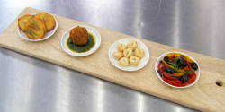 Geoff's antipasti board with chickpeas pancakes, porcini arancini, crisp breads and pepper ...