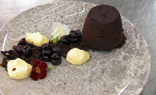 Delia's mulled wine chocolate fondant with cherry compote, orange cream and a chestnut ice ...
