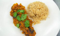 Amal's lamb meatballs in spicy tomato sauce with mustard and cardamon seeds rice and a gre ...