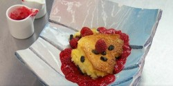 Zandra Rhodes bread and butter pudding with double cream and a raspberry coulis on Celebrity Mas ...