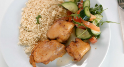 Otlile Mabuse's spiced chicken thighs with couscous and salad on Celebrity Masterchef 2019