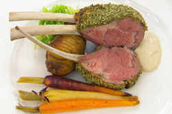 Greg Rutherford's tarragon and mint crusted rack of lamb with potatoes, a garlic and onion ...