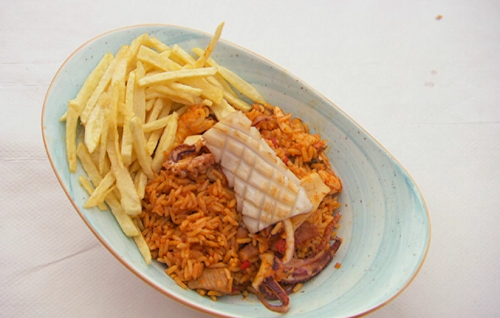 Neil and Greg's seafood rice dish with squid and chips on Celebrity Masterchef 2019