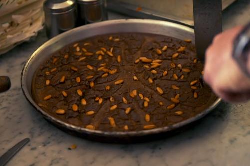 Castagnaccio flatbread dessert with chestnut flour and pine kernel on Gino's Italian Express