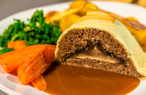 Ian and Henry (Bosh)'s Mushroom Wellington with vegetables and gravy on Living on the Veg