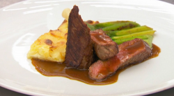 Beverley's lamb fillet with gratin dauphinois, courgettes and basil puree, and a lamb sauc ...
