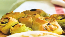 Jamie Oliver's homemade twister bread with black olives, cheddar cheese and green pesto on ...