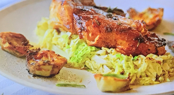 Ainsley Harriott's char-grilled lamb steaks and artichokes with a rosemary balsamic and honey gl ...