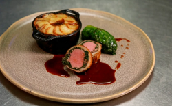 Tom Kitchin's stuffed saddle of lamb served with braised lettuce and boulangere potatoes cooked  ...