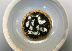 Tom Kitchin's braised north sea squid served on a potato risotto with squid ink tuile cook ...