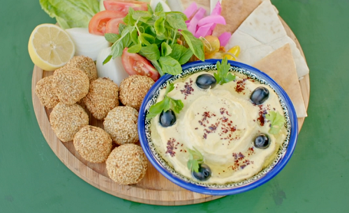 Ainsley Harriott herby falafels with homemade hummus, black olives and flatbread on Ainsley̵ ...
