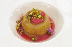 Riyadh's white chocolate steam pudding with rhubarb, elderflower, pistachios, gold leaf and edib ...
