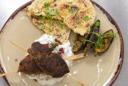 Riyadh's lamb kofta kebab with hummus, roasted aubergine and garlic and onion flatbread on Celeb ...