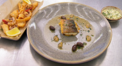 Gethin Jones sea bass with clams, olives and grilled polenta served with calamari and tartare sa ...