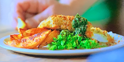 Jamie Oliver fish and chips with potato wedges and mushy vegetables on Jamie: Keep Cooking Famil ...