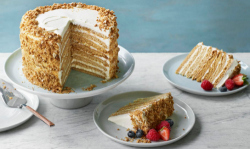 Nadiya Hussain Russian honey cake with soured cream, honey icing and topped with hazelnuts and b ...