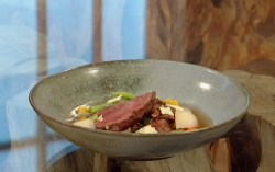 Matt Tebbutt traditional Welsh cawl broth with cabbage and diced vegetables on Saturday Kitchen