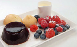 Crissy Rock's port and wine jelly with almond biscuits, berries and cream on Celebrity Mas ...