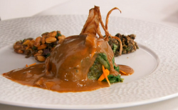 Santosh's jimbu spiced cannon of lamb wrapped in Nepalese mustard greens with a black ston ...
