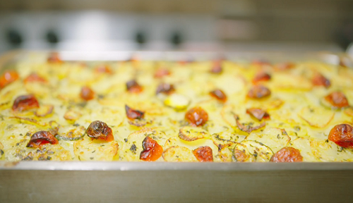 Hussain's baked layered potatoes, vegetables , rice and mussels dish on A Taste of Italy w ...
