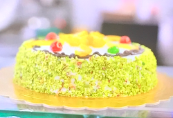 Cassata siciliana cake With chocolate buttons, ricotta cheese, candied fruit and pistachios on A ...