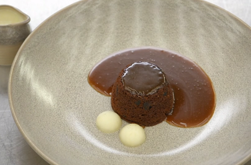 Steph's sticky toffee pudding with miso caramel sauce, poached apples and a vanilla custar ...